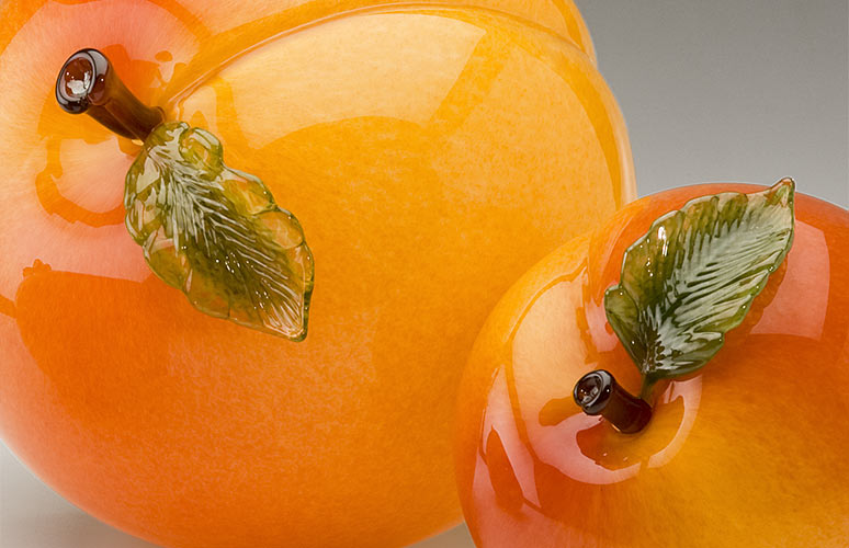 Hand blown glass peaches created by glass artists Michael Cohn and Molly Stone